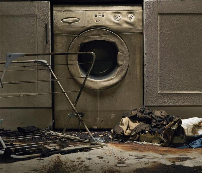 fire damaged laundry room and washer